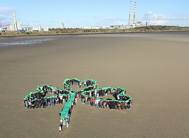 Undocumented migrants make a human shamrock on Sandymount strand in Dublin as part of the Justice for the Undocumented Campaign
