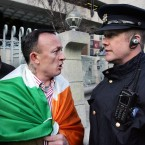 John Boland, centre, confronting a Garda while stand outside the Central Bank. Photo: Sam Boal/Photocall Ireland.