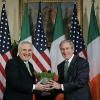 Together again: Bush accepts a given crystal bowl of shamrock from Bertie in 2007. (AP Photo/Pablo Martinez Monsivais/PA Images)