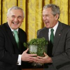 Bush and Bertie have gotten into the swing of things by their third shamrock exchange on St Patrick's Day, 2008. (AP Photo/Gerald Herbert, PA File)