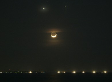 File photo of the planets Venus, top left, and Jupiter, top right, burning together in 2008