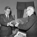 Ambassador Thomas Kiernan of Ireland presents a bowl of Irish shamrock to President John F Kennedy in 1961. Although you can't tell from this image, Kennedy wore a green tie for the occasion - one he borrowed from his appointments secretary Kenneth O'Donnell. (AP Photo/Harvey Georges/PA Images)