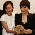 Angela Leong, right, wife of Macau tycoon Stanley Ho, holding the 1.5kg white truffle, celebrates with Mainland China's actress Zhou Xun after won the bid for US0,000 during an auction in 2007. (AP Photo/Ho Chon In)