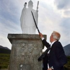 After climbing Croagh Patrick, he gives our patron saint a good poke.
