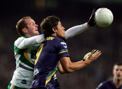 Coulter, left, challenges Garrick Ibbotson of Australia during the 2010 International Rules Series.