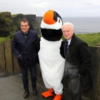 At the Cliffs of Moher with Marco and Paudie the Puffin. He's got a thing for mascots.