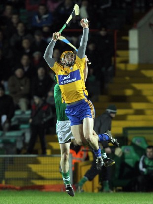 John Conlon beats Limerick's David Moloney to a high ball.