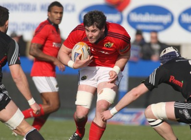 Munster's Dave O'Callaghan carries the ball.
