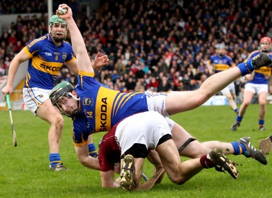 Tipperary's Brian O'Meara wins the ball as he goes to ground with David Collins of Galway.
