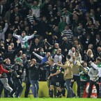 Shamrock Rovers supporters invade the pitch after Gary Twigg equalises in injury time against Cork City.