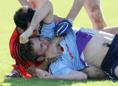 Down's Aiden Branigan and Alan Brogan of Dublin get up close and personal in Páirc Esler last weekend.