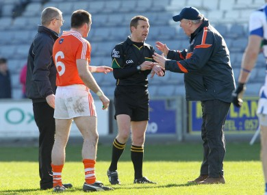 Assistant manager Paul Grimley appeals to referee Michael Duffy after sending off Ciaran McKeever before the start of the second half.