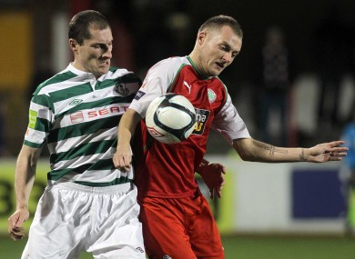 Cliftonville's Ciaran Caldwell and Rovers' Colin Hawkins compete for possession.