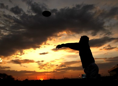 Munster's Damien Varley warms up in the fading light.