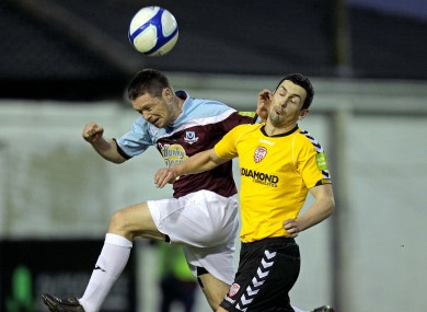 Goalscorer Brian Gannon (left) and Derry's Mark Farren.