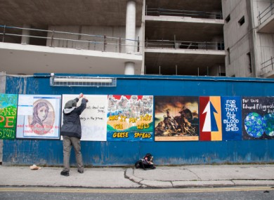 The artworks being pinned up earlier this month