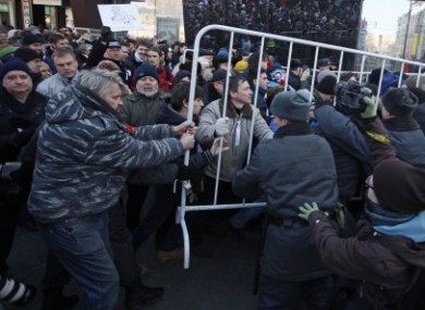 Opposition protesters clash with police in the centre of Moscow