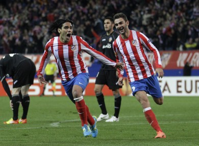 Radamel Falcao wheels away in celebration after his goal