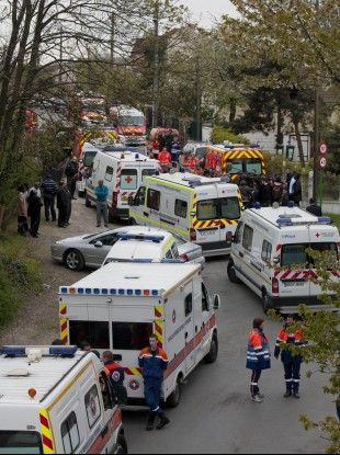 Emergency workers are seen around the area of a building accident, in Pierrefitte, north of Paris.