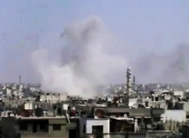 Smoke rises from Homs after what activists said was heavy shelling yesterday