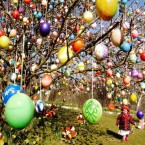 Elisa Marie Kraft walks under a tree decorated by her grandfather. (AP Photo/Jens Meyer)