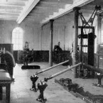 The gymnasium showing various fitness equipment on board the Titanic.