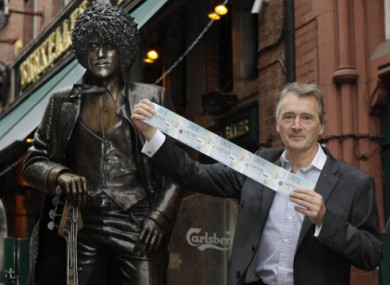 Lord Henry Mountcharles poses with the Phil Lynott statue in Dublin.
