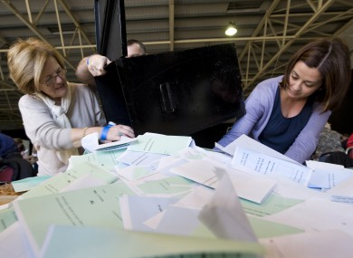 Polling staff open the ballot boxes for the count at last year's presidential election. The polling order for next month's referendum has been signed today.