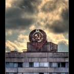 Soviet insignia on the roof of the Voskhod building.