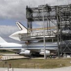 NASA workers attach Discovery to a shuttle carrier aircraft at the Kennedy Space Center ahead of its removal to the Smithsonian Air and Space Museum today. (Image: AP Photo/NASA/Kim Shiflett)