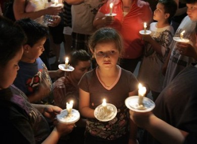 Children and parents at a candlelit vigil for Isabel Celis in Tucson on Sunday.