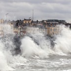 Waves crashing over the promenade in Sandycove, Co Dublin, as storms lash the whole east coast of Ireland. Pic: Justin Farrelly.