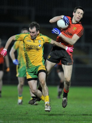 Gordon, right, in action against Donegal's Karl Lacey.