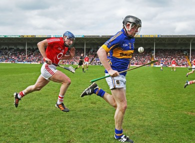 Donagh Maher breaks clear of Cork's Patrick Horgan.