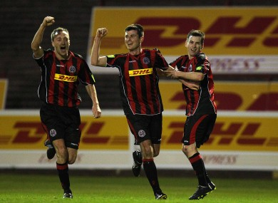 Bohs' Dinny Corcoran (centre) celebrates with teammates Dave Scully and Karl Moore.