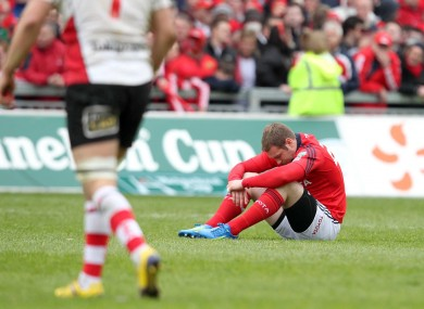 A dejected Johne Murphy after the defeat to Ulster at Thomond Park. 