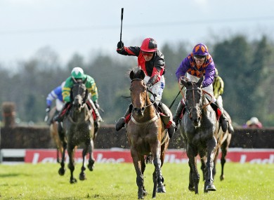 ndrew Thornton celebrates winning the Ladbrokes Irish Grand National Steeplechase on Lion Na Bearnai.
