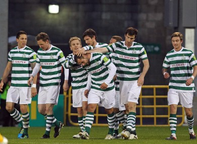 The Rovers players congratulate Chris Turner (centre). 