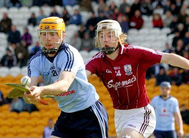 Oisin Gough races away from Padraig Brehony