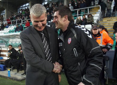 Shamrock Rovers manager Stephen Kenny and Derry City manager Declan Devine share a word before this evening's game in Tallaght.