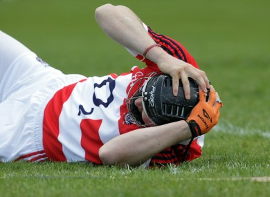 Cork captain and goalkeeper Donal Og Cusack lies in pain after suffering the injury.