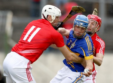 Cork's Pa Cronin and Lorcan McLoughlin bottle up James Woodlock of Tipperary