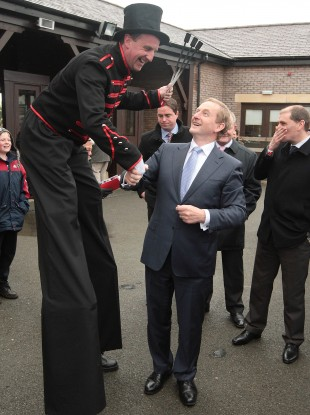 Taoiseach Enda Kenny meets one of the performers at Punchestown yesterday.