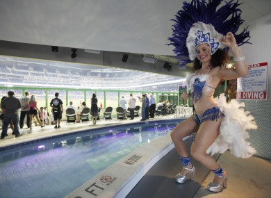 A costumed dancer performs in front of the pool at Marlins Park.