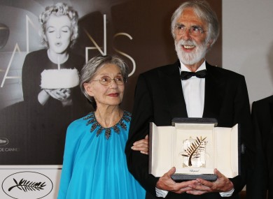 Michael Haneke, right, poses for photographers with the Palme d'Or award for Love alongside Emmanuelle Riva