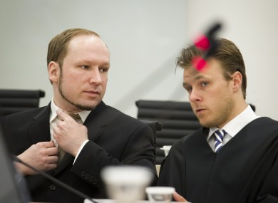 Anders Behring Breivik talks with Tord Jordet, one of his lawyers