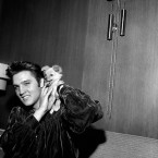Elvis Presley plays with his puppy Sweet Pea on 18 October 1956. The evening before he had gotten into a fistfight with two filling station attendants, one of whom received a black eye. Presley said one of the men slapped him as he was signing autographs. (AP Photo/Gene Herrick/Press Association Images)