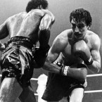 Barry McGuigan, right, ducks to his left as American Bernard Taylor attacks during the World Boxing Association Title fight in the Kings Hall, Belfast, on Sept. 28, 1985. McGuigan retained his title after Taylor's corner threw in the towel in the eighth round. 