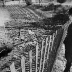 Twelve-year-old Todd Domboski of Centralia, looking over a police barricade at the hole he fell through just hours before the photo was taken on 14 February, 1981. (Image: AP Photo)