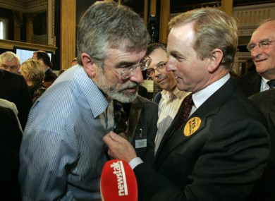 Enda Kenny with Gerry Adams in 2009 (File photo)
